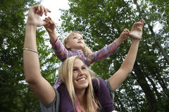 Mother and daughter. Mother daughter piggy back ride Stock Photos