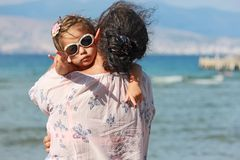 Mother and daughter. Hug on the sunny day stock photography