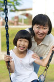 Mother and daughter. Asian mother and daughter at the playground Stock Photo