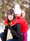 Mother and daughter. Happy  family; mother and daughter  outdoor on a warm winter day Royalty Free Stock Photography