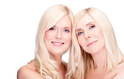 Mother and daughter. Natural beauty, over white Royalty Free Stock Photos