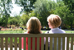 Mother and Daughter. Relaxing on a bench in a park Stock Photo