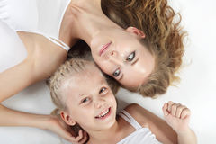 Mother and daughter. On white Stock Photo