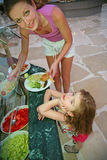 Mother and daughter. Mother and the daughter choose meal royalty free stock photos