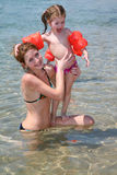 Mother and daughter. On beach stock photos