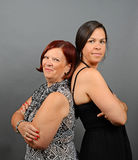 A mother and daughter. Image of a mother and daughter back to back Stock Photography