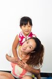 Mother and daughter. Happy mother and daughter hug royalty free stock photo