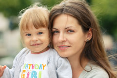 Mother with daughter. Outdoor portrait of mother and daughter Royalty Free Stock Photo