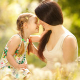 Mother and daughter. In the park Stock Photos