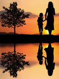 Mother and daughter. In the park and beautiful sunset Royalty Free Stock Photography