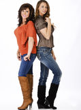 Mother daughter. Two women posing together in boots Royalty Free Stock Images