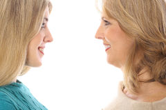 Mother & daughter. Mother & daughter looking at each other isolated on a white background Stock Photography
