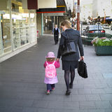 Mother and Daughter. Mother walks her daughter to school, holding hands Royalty Free Stock Photo