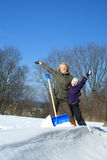 Mother and daughter. Shoveling and have fan outside Royalty Free Stock Photos