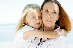 Mother and daughter. Woman holding with her little girl Royalty Free Stock Photo