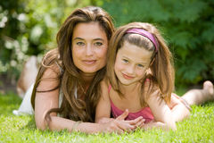 Mother and daughter. Beautiful pair of mother and daughter outside in the grass Stock Photography