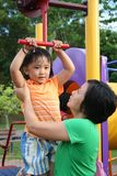 Mother & daughter. Mother carrying daughter playing at the park in the afternoon Stock Photo