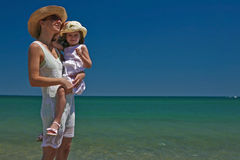 Mother and daughter. Mother and daughter enjoy hot summer weather at the beach Royalty Free Stock Photo