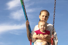 Mother & Daughter. On a swing royalty free stock photography