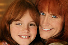 Mother and daughter. Red-headed mother and daughter smiling and hugging Stock Image