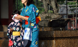 Mother and daughter. Wearing kimonos royalty free stock photography