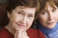 Mother and daughter. Mature daughter and old mother Stock Photography