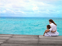Mother and daughter. Sitting near the ocean Royalty Free Stock Photography