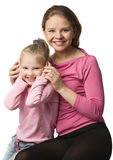 Mother and daughter. Young mother and daughter in pink clothes, isolated on white Stock Photo