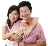 Mother & Daughter. Adult Daughter  Happy Asian Mother and Adult Daughter with carnation flower Royalty Free Stock Image