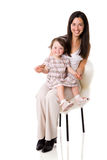 Mother with daughter. Sitting isolated Royalty Free Stock Photography