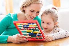 Mother and daughter with abacus Stock Image
