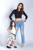 Mother and daughter acting post. Asian thai mother and daughter acting post like model on white screen Stock Image