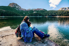 Mother and daughter admiring beautiful panorama of Black Lake ( Royalty Free Stock Images
