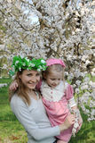 Mother and daughter admiring spring tree Stock Photo