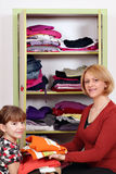 Mother and daughter agrees clothes Stock Image