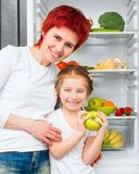 Mother and daughter in the kitchen Stock Images