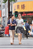 Mother and daughter arm in arm on zebra crossing, Nanjing, China Royalty Free Stock Images
