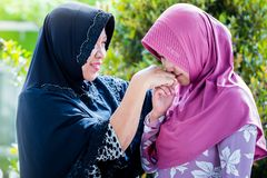 Mother and daughter from Asia forgive each other. During ied or Islamic celebration Royalty Free Stock Images