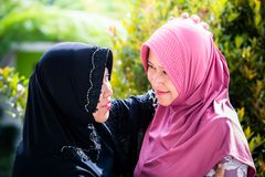 Mother and daughter from Asia forgive each other. During ied or Islamic celebration Stock Photography