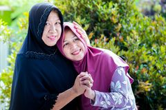 Mother and daughter from Asia forgive each other. During ied or Islamic celebration Stock Images