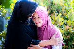 Mother and daughter from Asia forgive each other. During ied or Islamic celebration Stock Photo