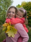 Mother with daughter in autumn Stock Photography