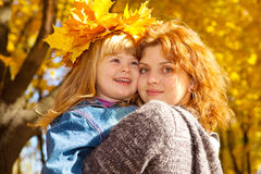 Mother and daughter in autumn Royalty Free Stock Image