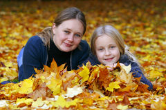 Mother and daughter in Autumn stock image