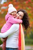 Mother with daughter in autumn Stock Images