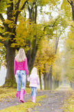 Mother and daughter in autumn Stock Photos