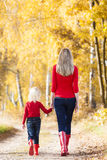 Mother and daughter in autumn Royalty Free Stock Photos