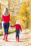 Mother and daughter in autumn Stock Photography