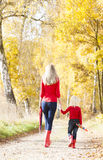 Mother and daughter in autumn Stock Images