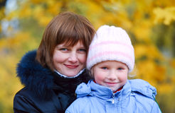 Mother with daughter in autumn city park Stock Image